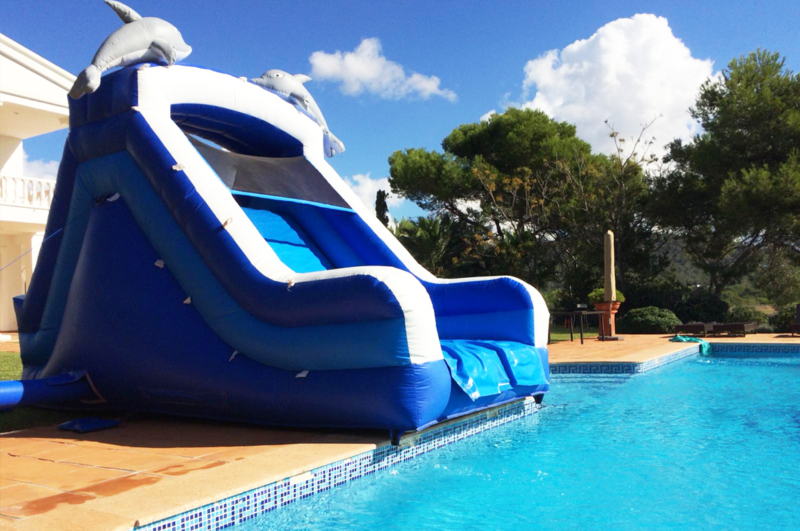 The perfect picture! Dolphin inflatable water slide - family fun in Ibiza
