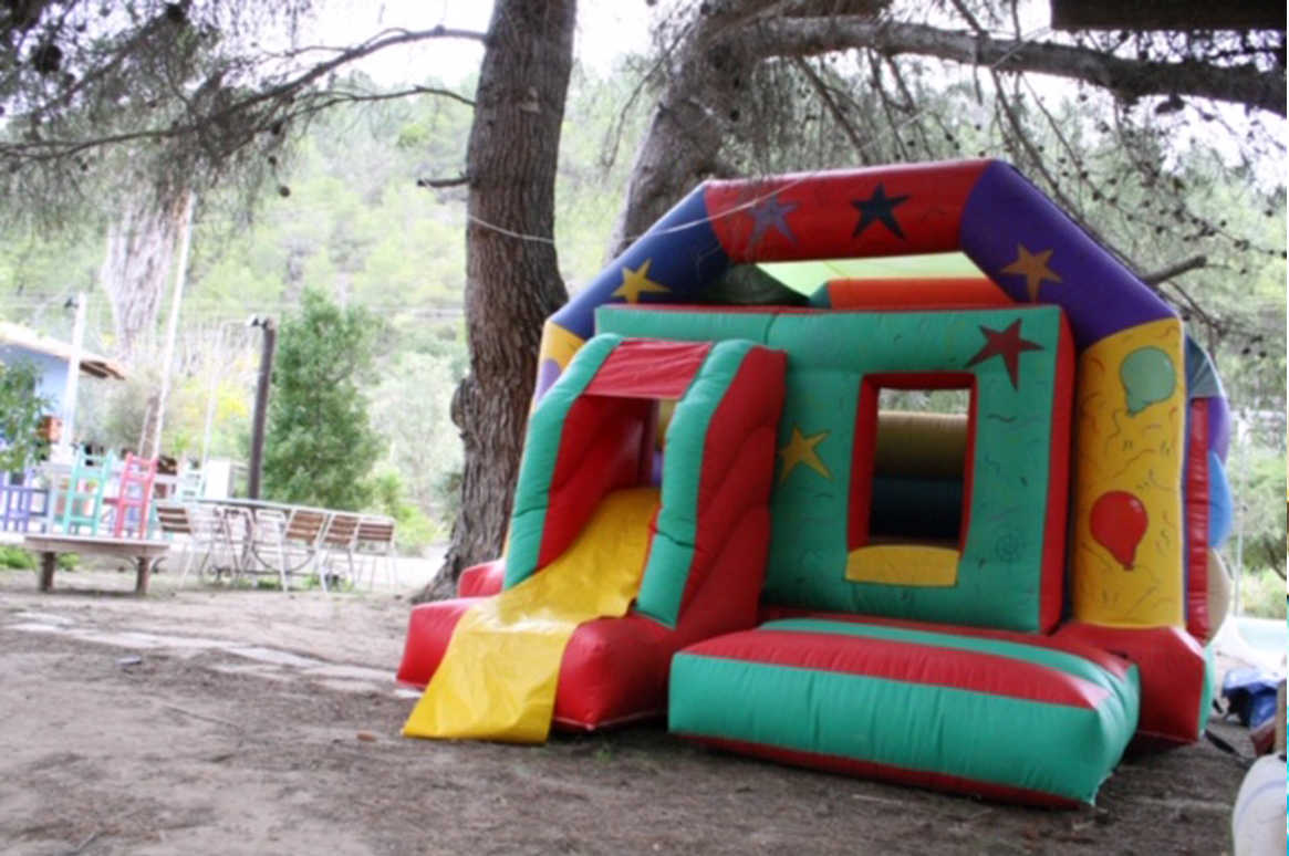 Stand out attraction! The 'Fun House' bouncy castle for your party or event here in Ibiza