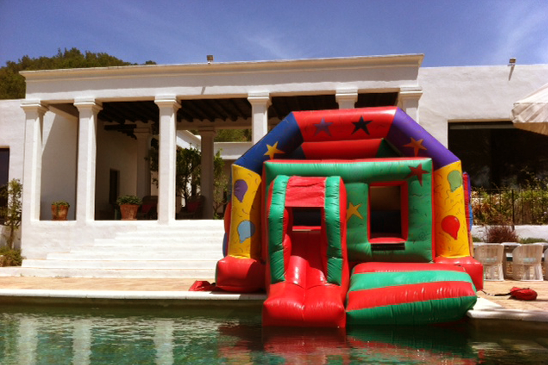 The Fun House Bouncy Castle with inflatable slide ready for a Pool Party in Ibiza