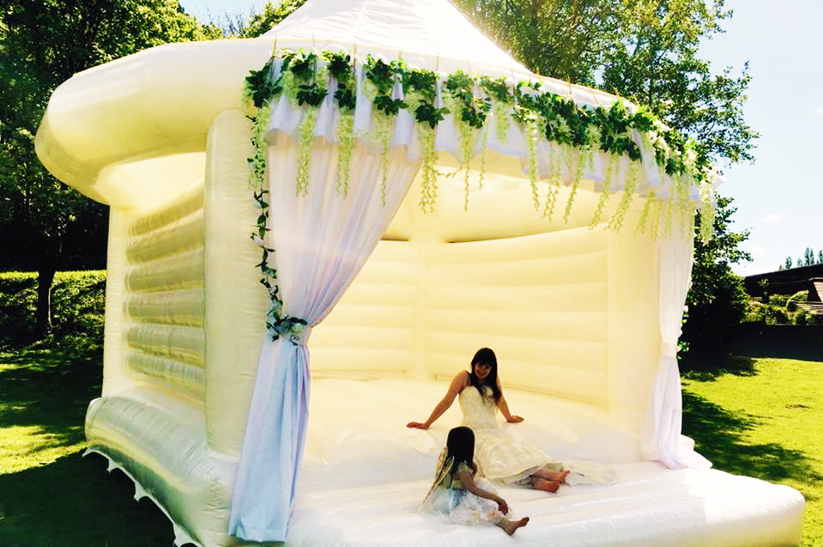 The perfect Wedding photo! The White Castle - Fairytale Ibiza's exclusive Wedding Bouncy Castle